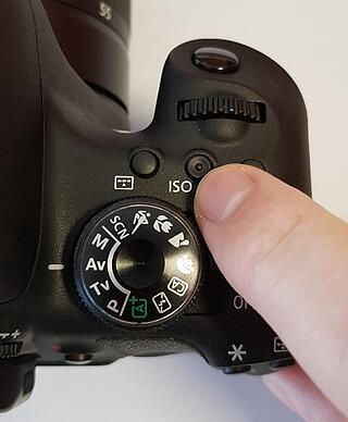 Pressing the ISO Button of a Canon EOS Digital SLR Camera