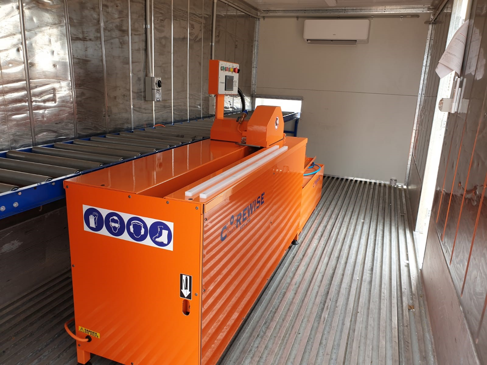 The Corewise Automatic Core Saw inside a container